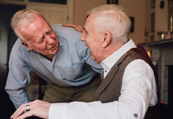 Men with alzheimers disease taking part in a program for people with dementia